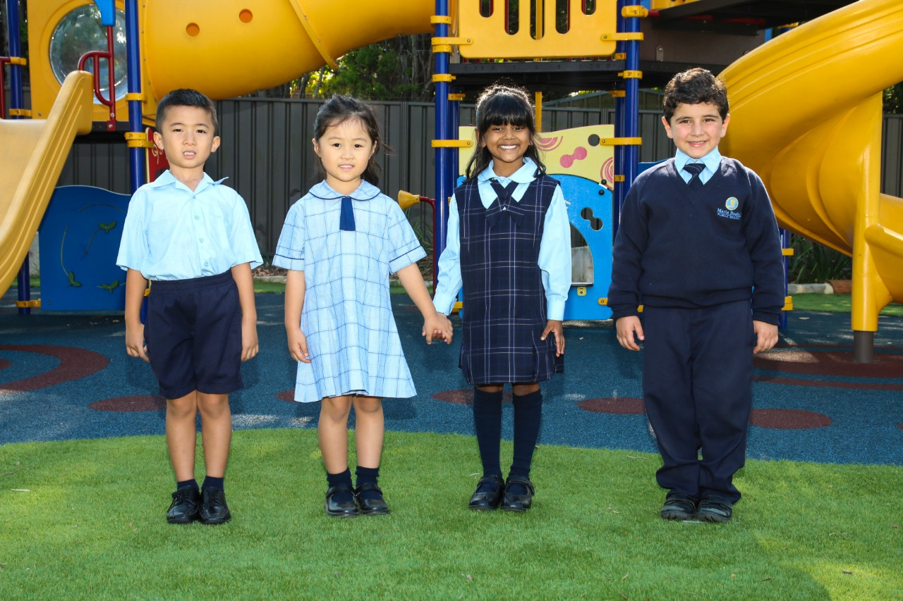 Students wearing summer and winter uniforms.