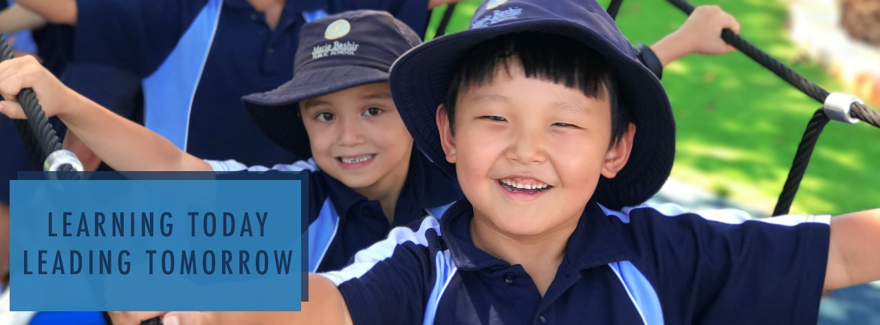 The school website banner is an image of students on the new play equipment with the quote Learning today, Leading tomorrow.