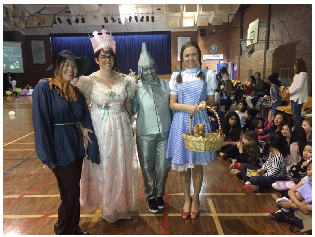 Teachers dressed up as characters from Wizard of Oz at book parade.