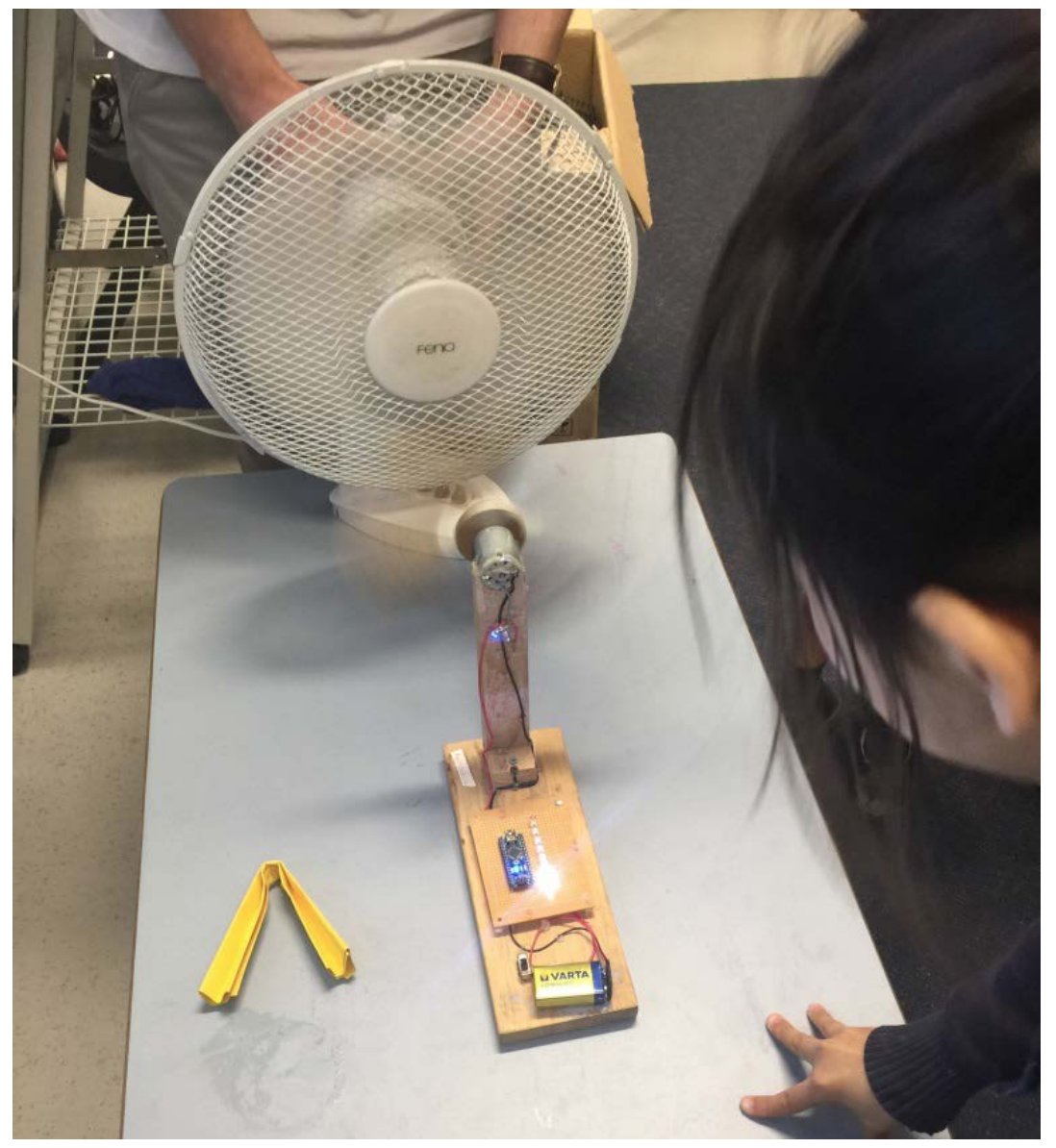 Students creating an invention that involves fan power.